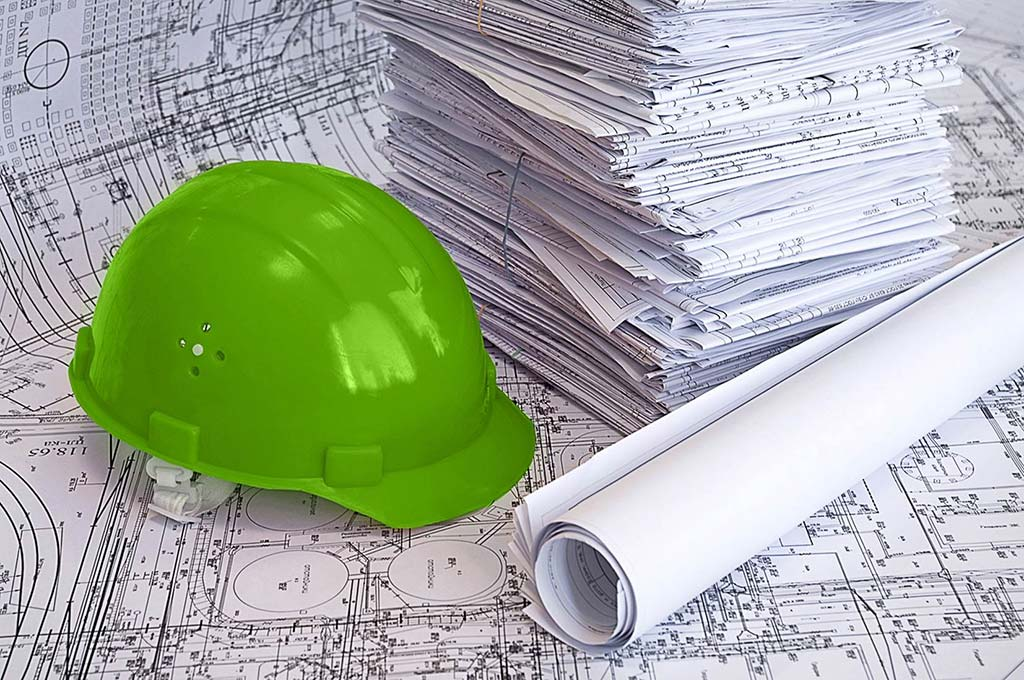 Green hard hat and blue prints